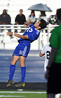 NWA Democrat-Gazette/CHARLIE KAIJO Rogers High School Brayan Flores (17) heads the ball during a soccer game, Friday, April 26, 2019 at  Whitey Smith Stadium at Rogers High School in Rogers.