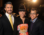 From left: Fernando and Sarah Aramburo with Jeffrey Walters on the red carpet at Fashion Houston 5 at the Wortham Theater Friday Nov. 21, 2014.(Dave Rossman photo)