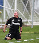 Ally McCoist on the deck laughing at training