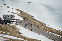 last riders descending the Passo dello Stelvio (alt: 2758m)<br /> <br /> Stage 16: Rovett › Bormio (222km)<br /> 100th Giro d'Italia 2017
