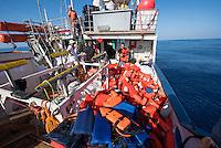 Sea Watch-2.<br /> Die Sea Watch-2 bei ihrer 13. SAR-Mission vor der libyschen Kueste.<br /> Im Bild: Crew-Mitglieder der Sea Watch-2 sortieren nach einem Rettungseinsatz die benutzten Schwimmwesten.<br /> 20.10.2016, Mediterranean Sea<br /> Copyright: Christian-Ditsch.de<br /> [Inhaltsveraendernde Manipulation des Fotos nur nach ausdruecklicher Genehmigung des Fotografen. Vereinbarungen ueber Abtretung von Persoenlichkeitsrechten/Model Release der abgebildeten Person/Personen liegen nicht vor. NO MODEL RELEASE! Nur fuer Redaktionelle Zwecke. Don't publish without copyright Christian-Ditsch.de, Veroeffentlichung nur mit Fotografennennung, sowie gegen Honorar, MwSt. und Beleg. Konto: I N G - D i B a, IBAN DE58500105175400192269, BIC INGDDEFFXXX, Kontakt: post@christian-ditsch.de<br /> Bei der Bearbeitung der Dateiinformationen darf die Urheberkennzeichnung in den EXIF- und  IPTC-Daten nicht entfernt werden, diese sind in digitalen Medien nach §95c UrhG rechtlich geschuetzt. Der Urhebervermerk wird gemaess §13 UrhG verlangt.]