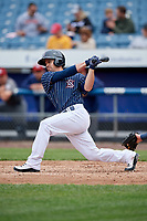 Syracuse Chiefs catcher Tuffy Gosewisch (11) follows through on a swing during a game against the Lehigh Valley IronPigs on May 20, 2018 at NBT Bank Stadium in Syracuse, New York.  Lehigh Valley defeated Syracuse 5-2.  (Mike Janes/Four Seam Images)