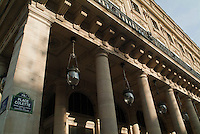 Streetlamps and columns outside a building on the Place Colette, Paris, France.