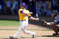 LSU Tigers third baseman Christian Ibarra #14 follows through on his swing against the Auburn Tigers in the NCAA baseball game on March 24, 2013 at Alex Box Stadium in Baton Rouge, Louisiana. LSU defeated Auburn 5-1. (Andrew Woolley/Four Seam Images).