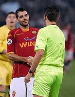 Calcio, Serie A: Roma vs Lazio. Roma, stadio Olimpico, 16 novembre 2008. .Football, Italian serie A: Roma vs Lazio. Rome, Olympic stadium, 16 november 2008. AS Roma midfielder Simone Perrotta shakes hands with referee Gianluca Rocchi after receiving a red card..UPDATE IMAGES PRESS/Riccardo De Luca