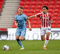 21st April 2021; Bet365 Stadium, Stoke, Staffordshire, England; English Football League Championship Football, Stoke City versus Coventry; Leo Ostigard of Coventry City under pressure from  Christian Norton of Stoke City