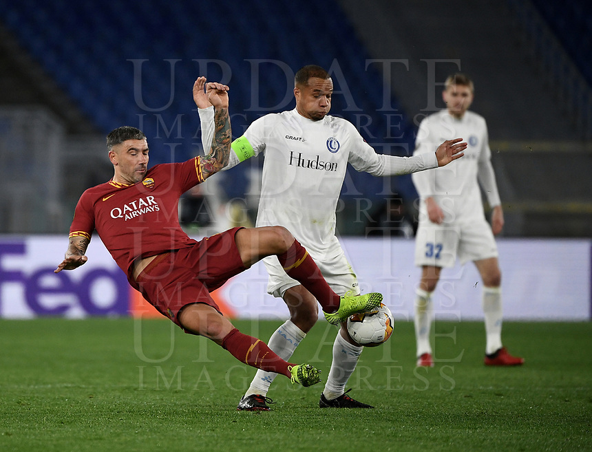 Football Soccer: UEFA Europa League round of 32 first leg AS Roma vs KAA Gent, Olympic stadium, Rome, 20 February, 2020.<br /> Roma's Alexandar Kolarov (l) in action with Gent's captain Vadis Odjidja (r) during the Europa League football match between Roma and Gent at the Olympic stadium in Rome on 20 February, 2020.<br /> UPDATE IMAGES PRESS/Isabella Bonotto