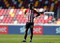 17th April 2021; Brentford Community Stadium, London, England; English Football League Championship Football, Brentford FC versus Millwall; Ivan Toney of Brentford hands on hips looking frustrated