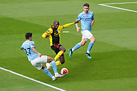 Joao Cancelo of Man City and Abdoulaye Doucoure of Watford during the Premier League match between Watford and Manchester City at Vicarage Road, Watford, England on 21 July 2020. Football Stadiums around remain empty due to the Covid-19 Pandemic as Government social distancing laws prohibit supporters inside venues resulting in all fixtures being played behind closed doors until further notice.<br /> Photo by Andy Rowland.