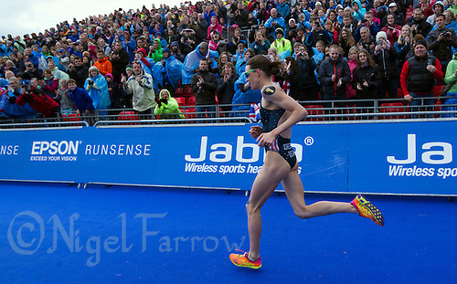 31 MAY 2015 - LONDON, GBR - Race leader Gwen Jorgensen (USA) from the USA runs along the finish chute as she wins the elite women's 2015 ITU World Triathlon Series round in Hyde Park, London, Great Britain (PHOTO COPYRIGHT © 2015 NIGEL FARROW, ALL RIGHTS RESERVED)