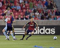 Real Salt Lake midfielder Will Johnson (8) prepares to pounce on loose ball. Real Salt Lake tied the Colorado Rockies, 1-1, at Rio Tinto Stadium on June 6, 2009.