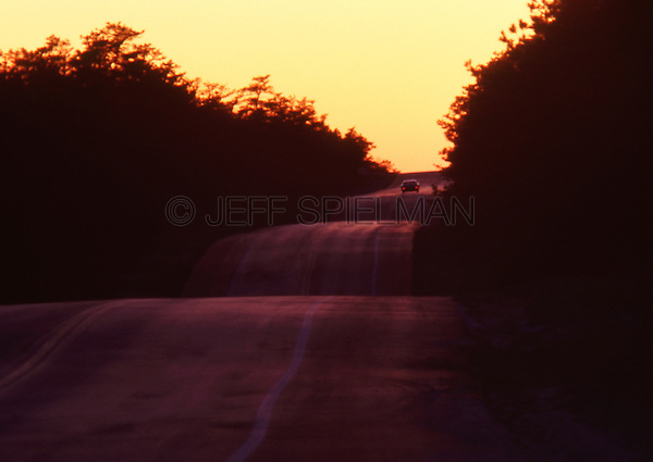 Original Image Photographed in August, 1981 on Kodachrome Color Transparency Film.<br /> <br /> Lone Car on a Highway at Dusk in the New Jersey Pine Barrens, near the town of Chatsworth, New Jersey, USA