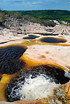 Parque Nacional de Chapada Diamantina, Lencois, Bahia, Brazil: Piscinas do Rocandor, the famous cascading natural pools of Rio Rocandor. --- Info: In response to the growing ecotourism in 1985 the Chapada Diamantina National Park (Parque Nacional da Chapada Diamantina) was established as a 1520 sqkm national park approximately 400 kilometres inland from Salvador de Bahia. Today the Chapada Diamantina is recognized as one of Brazil top hiking and outdoor activities destinations. The National Park is a beautiful region comprising of table top mountains, gorges, waterfalls, huge caves and crystalline lakes and bathing pools. Lencois is the main access point to the Chapada Diamantina.
