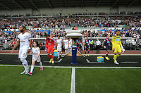 Pictured: Ashley Williams (L) and Tim Krul (R) lead their teams to the pitch Saturday 15 August 2015<br /> Re: Premier League, Swansea City v Newcastle United at the Liberty Stadium, Swansea, UK.