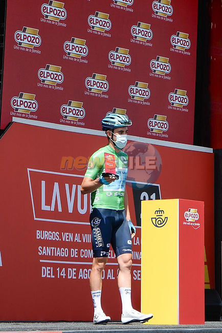 Most aggressive rider from yesterday's stage Alexander Aranburu Deba (ESP) Astana-Premier Tech wearing the Green Jersey today at sign on before Stage 2 of La Vuelta d'Espana 2021, running 166.7km from Caleruega. VIII Centenario de Santo Domingo de Guzmán to Burgos. Gamonal, Spain. 15th August 2021.    <br /> Picture: Cxcling   Cyclefile<br /> <br /> All photos usage must carry mandatory copyright credit (© Cyclefile   Cxcling)