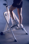 woman exercising step machine