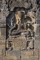 Borobudur, Java, Indonesia.  The Lord Shiva (Javanese: Siwa) with Crown, Sitting in Lotus Position.
