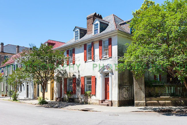 Historic antebellum residences, including the so called Pirates House, on Church Street in the French Quarter District of Charleston, South Carolina.