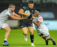 8th October 2021;  Swansea.com Stadium, Swansea, Wales; United Rugby Championship, Ospreys versus Sharks; Owen Watkin of Ospreys is tackled by Kerron van Vuuren and Phepsi Buthelezi of Cell C Sharks