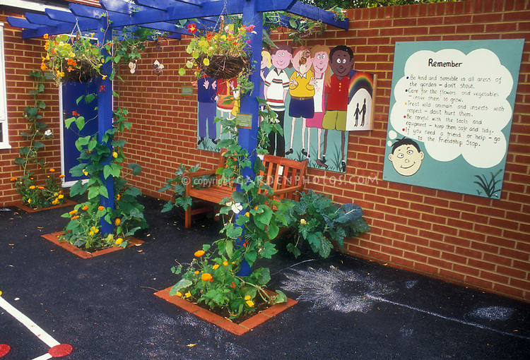 Elementary School Garden and Rules, with brick building, mural, playground, climbing vines
