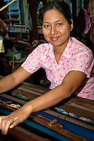 Myanmar, Burma, Mandalay.  Burmese Woman Working at a Loom.