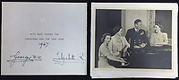 BNPS.co.uk (01202 558833)<br /> Pic: Rowleys/BNPS<br /> <br /> Pictured: 1947 - King George and the Queen Mother with Princesses Elizabeth and Margaret sold for £200<br /> <br /> <br /> A series of Christmas cards sent by the Royal Family to a married couple on their staff over a 25 year period have sold for £2,000.<br /> <br /> Most of the cards were sent by the Queen and Prince Philip and show the changing face of the monarchy from the black-and-white post war world to the colourful 1970s.<br /> <br /> They were sent to the couple who worked at Balmoral, the wife in the house and the husband on the estate.<br /> <br /> The cards were sold individually with the most expensive being the one for Christmas 1947 which was signed by King George VI and the Queen Mother.