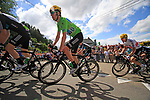 The peloton including Sky Procycling's Bradley Wiggins (GBR) wearing the Green Jersey round a hairpin to climb the Cote de Lierneux during Stage 1 of the 99th edition of the Tour de France, running 198km from Liege to Seraing, Belgium. 1st July 2012.<br /> (Photo by Eoin Clarke/NEWSFILE)