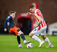 20th February 2021; Bet365 Stadium, Stoke, Staffordshire, England; English Football League Championship Football, Stoke City versus Luton Town; Sam Vokes of Stoke City is tackled by Luke Berry of Luton Town