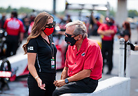 Aug 9, 2020; Clermont, Indiana, USA; NHRA team owner Don Schumacher (right) with daughter Megan Schumacher during the Indy Nationals at Lucas Oil Raceway. Mandatory Credit: Mark J. Rebilas-USA TODAY Sports