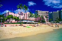 "The beachfront of the fabulous Royal Hawaiian Hotel, or """"pink palace"""", a Waikiki historic landmark."