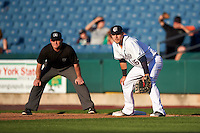 Syracuse Chiefs first baseman Matt Skole (16) holds a runner on first as umpire Jonathan Bailey looks on during a game against the Louisville Bats on June 6, 2016 at NBT Bank Stadium in Syracuse, New York.  Syracuse defeated Louisville 3-1.  (Mike Janes/Four Seam Images)
