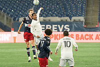 FOXBOROUGH, MA - NOVEMBER 1: Henry Kessler #4 of New England Revolution and Ola Kamara #9 of DC United battle for a head ball during a game between D.C. United and New England Revolution at Gillette Stadium on November 1, 2020 in Foxborough, Massachusetts.