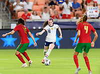 HOUSTON, TX - JUNE 10: Rose Lavelle #16 of the United States brings the ball up the field attempting to dribble by Carole Costa #15 of Portugal during a game between Portugal and USWNT at BBVA Stadium on June 10, 2021 in Houston, Texas.