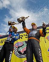 May 11, 2013; Commerce, GA, USA: NHRA funny car driver Johnny Gray (right) and top fuel dragster driver Antron Brown celebrate after winning the Southern Nationals at Atlanta Dragway. Mandatory Credit: Mark J. Rebilas-