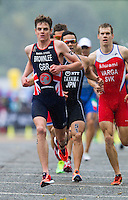 15 SEP 2013 - LONDON, GBR - Jonathan Brownlee (GBR) of Great Britain leads the front pack at the start of the first run lap at the elite men's ITU 2013 World Triathlon Series Grand Final in Hyde Park, London, Great Britain (PHOTO COPYRIGHT © 2013 NIGEL FARROW, ALL RIGHTS RESERVED)