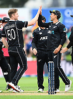 20th March 2021; Dunedin, New Zealand;  Jimmy Neesham and Trent Boult celebrate the wicket of Liton Das during the New Zealand Black Caps v Bangladesh International one day cricket match. University Oval, Dunedin.