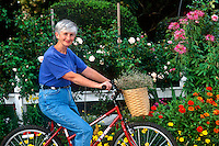 Senior woman on bicycle.