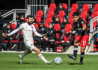 WASHINGTON, DC - FEBRUARY 29: Yamil Asad #11 of DC United sends a pass away from Jack Price #19 of the Colorado Rapids during a game between Colorado Rapids and D.C. United at Audi Field on February 29, 2020 in Washington, DC.