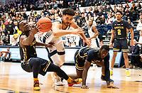WASHINGTON, DC - FEBRUARY 22: Arnaldo Toro #11 of George Washington and David Betty #1 of La Salle clash during a game between La Salle and George Washington at Charles E Smith Center on February 22, 2020 in Washington, DC.