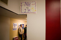 Volunteers gather at the New Hampshire campaign headquarters of GOP presidential candidate and former Utah governor Jon Huntsman in Manchester, New Hampshire, on Jan. 7, 2012.  Huntsman is seeking the 2012 Republican presidential nomination.