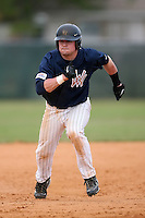 February 22, 2009:  Third baseman Justin Parks (20) of West Virginia University during the Big East-Big Ten Challenge at Naimoli Complex in St. Petersburg, FL.  Photo by:  Mike Janes/Four Seam Images