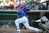 Javy Baez #12 of the Iowa Cubs swings against the Omaha Storm Chasers at Principal Park on July 2, 2014 in Des Moines, Iowa. The Cubs  beat Storm Chasers 4-3.   (Dennis Hubbard/Four Seam Images)