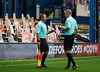 3rd October 2020; Kenilworth Road, Luton, Bedfordshire, England; English Football League Championship Football, Luton Town versus Wycombe Wanderers; Referee Graham Scott talks to Assistant Referee Henry Lennard after he flagged Scott Kashket of Wycombe Wanderers goal as offside