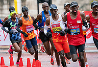 4th October 2020, London, England; 2020 London Marathon; Mosinet Geremew (ETH) takes a drink in the leading pack in the Elite Men's Race.The historic elite-only Virgin Money London Marathon taking place on a closed-loop circuit around St James's Park in central London on Sunday 4 October 2020.