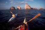 Mexico, Sea kayakers paddle toward sea stacks, Bahia Tenacatita, Bara de Navidad, West coast of Mexico