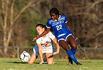 LITCHFIELD, CT-110620S12—Northwestern's Christina Topper (18) gets tripped up while she and Litchfield's Jeremina Prenoveau (22) battle for the ball during their Berkshire League game Friday at Litchfield High School. <br /> Jim Shannon Republican-American