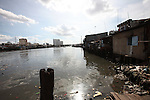Shanties line the banks of the Saigon River in District 4, Ho Chi Minh City, Vietnam. Sept. 9, 2011.