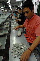 Older male workers at Jet Shoe Manufacturing in  Houjie Town, Donguan, China.  Jet is struggling to find workers and ir running at half capacity and employing may older men rather than young women. As the economy changes and Chinese labour gets more expensive, factories are cosing leaving ghost towns behind them.<br /> <br /> MUST CREDIT PHOTO BY RICHARD JONES/SINOPIX