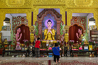 Statue of the Buddha in Dhammikarama Burmese Temple, George Town, Penang, Malaysia.