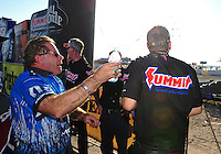 Oct. 30, 2011; Las Vegas, NV, USA: NHRA pro stock driver Jason Line (right) is congratulated by Allen Johnson after clinching the 2011 pro stock world championship at the Big O Tires Nationals at The Strip at Las Vegas Motor Speedway. Mandatory Credit: Mark J. Rebilas-